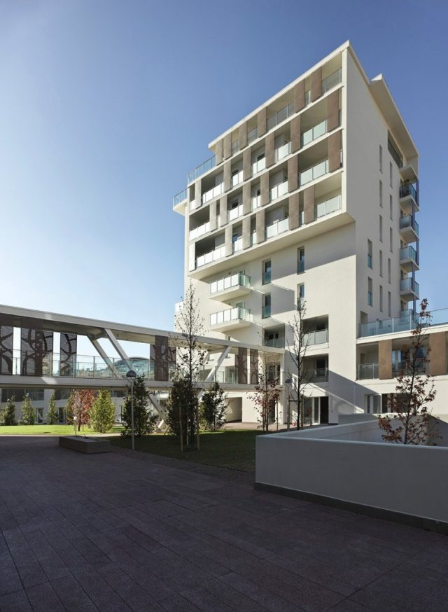 """意大利米兰""""Via Cenni""""住宅区 – 4 栋建筑,每栋 9 层,全部使用 CLT 建造(1楼也未使用混凝土),2013 年建成。"""