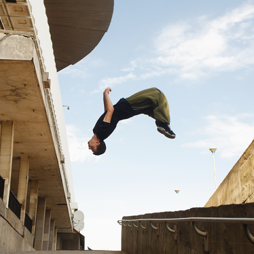 Parkour runner doing a back flip