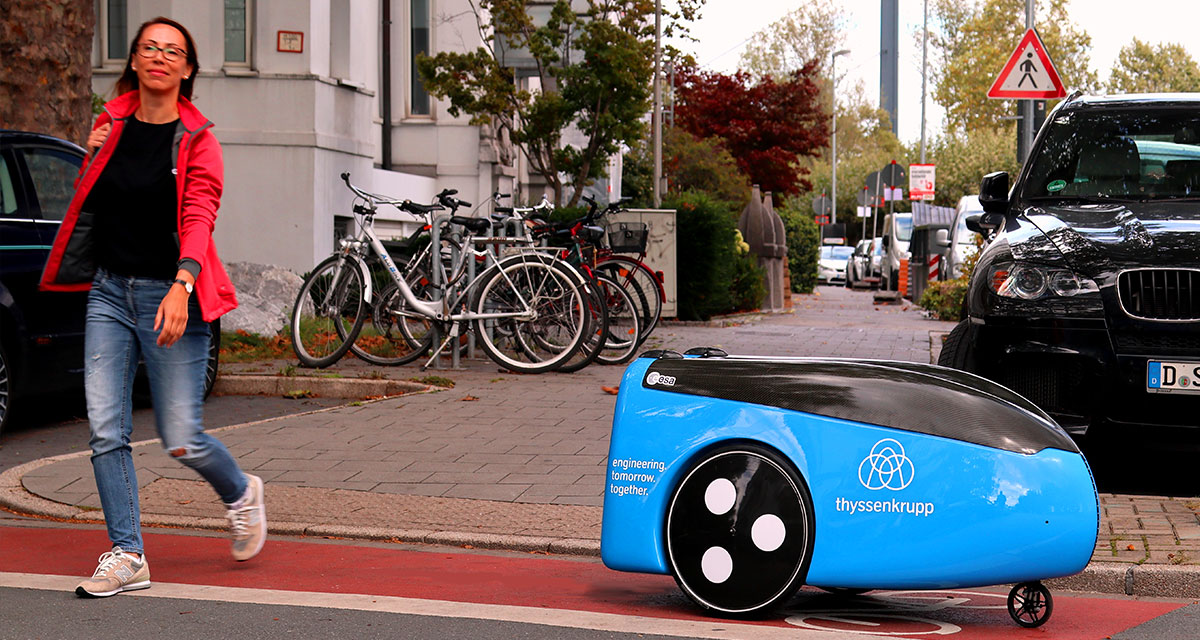A robot's commute to work: on the road to elevator service.